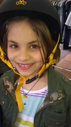 A cutie wearing the Silver Faceted Gem Stone. She proves you are never too young to layer or wear jewelry
