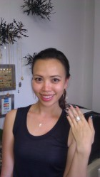 Kathy from Vietnam in Gold Hoops, Silver Adjustable Ring & Brushed Silver Leaf Necklace